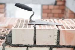 Технология кирпичной кладки: принципы возведения стен (видео)